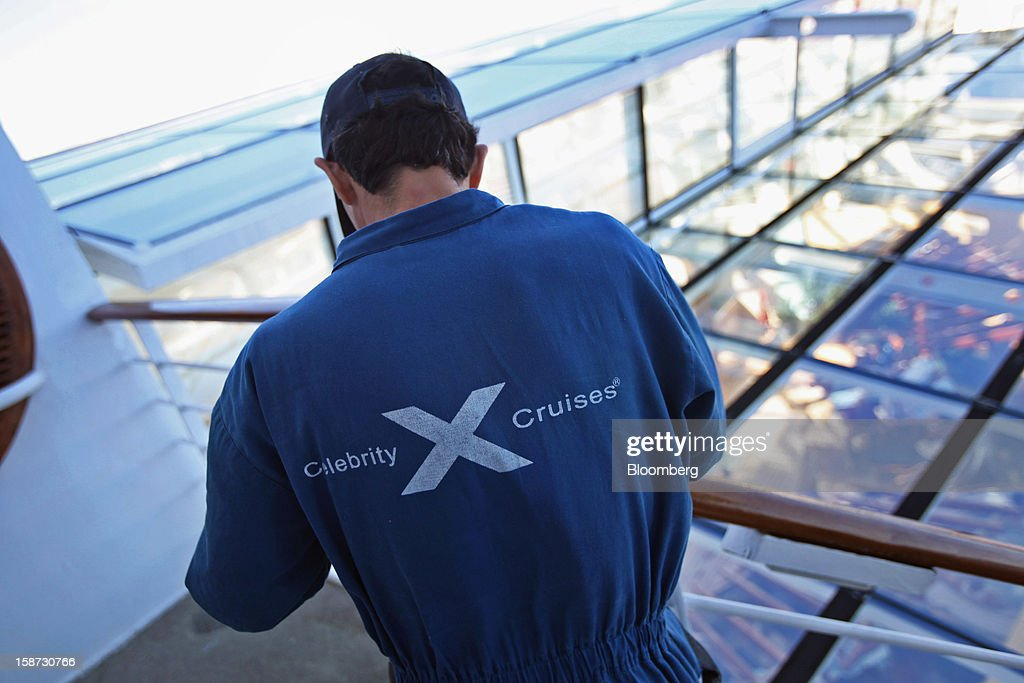 A worker prepares a railing for paint aboard Celebrity Cruises Inc.'s Constellation cruise ship in the Caribbean Sea near the coast of Cuba on Sunday, Dec. 16, 2012. Royal Caribbean Cruises Ltd. is a global cruise vacation company that operates Azamara Club Cruises, Celebrity Cruises, CDF Croisieres de France, Pullmantur Cruises and Royal Caribbean International. Photographer: Tim Boyle/Bloomberg via Getty Images