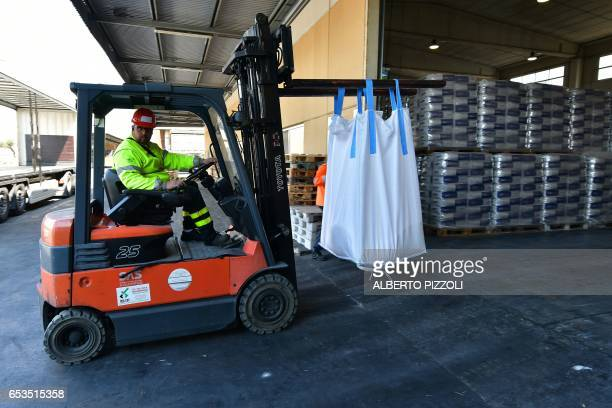 A worker prepares a shipment at the French sugar cooperative Cristal UnionSFIR Raffineria di Brindisi sugar refinery in Brindisi on March 15 2017...