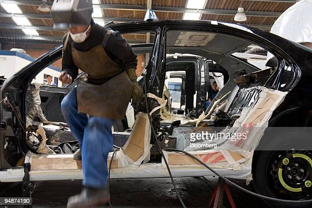 A worker prepares a vehicle for armor in the AutoSafe factory of Wendler Blindajes Alemanes in Mexico City Mexico on Friday Feb 22 2008 WBA with its...