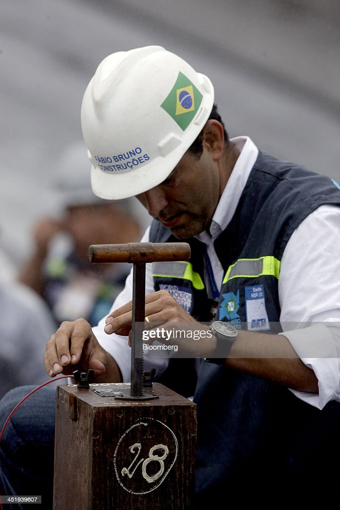 A worker prepares an electrical trigger that will be used to demolish a 5 km-long stretch of highway to make way for the revitalization of the port area in Rio de Janeiro, Brazil, on Saturday, Nov. 23, 2013. The government will auction three highways before year-end, Finance Minister Guido Mantega told reporters Nov. 22 in Brasilia. Photographer: Dado Galdieri/Bloomberg via Getty Images