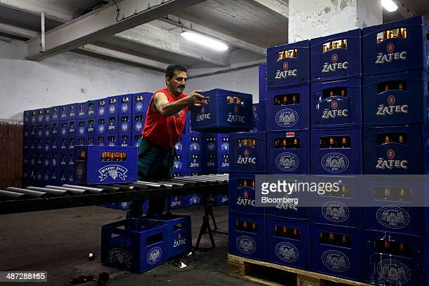 A worker prepares crates of Zatec beer for distribution at the Zatecky Pivovar brewery in Zatec Czech Republic on Monday April 28 2014 Carlsberg A/S...