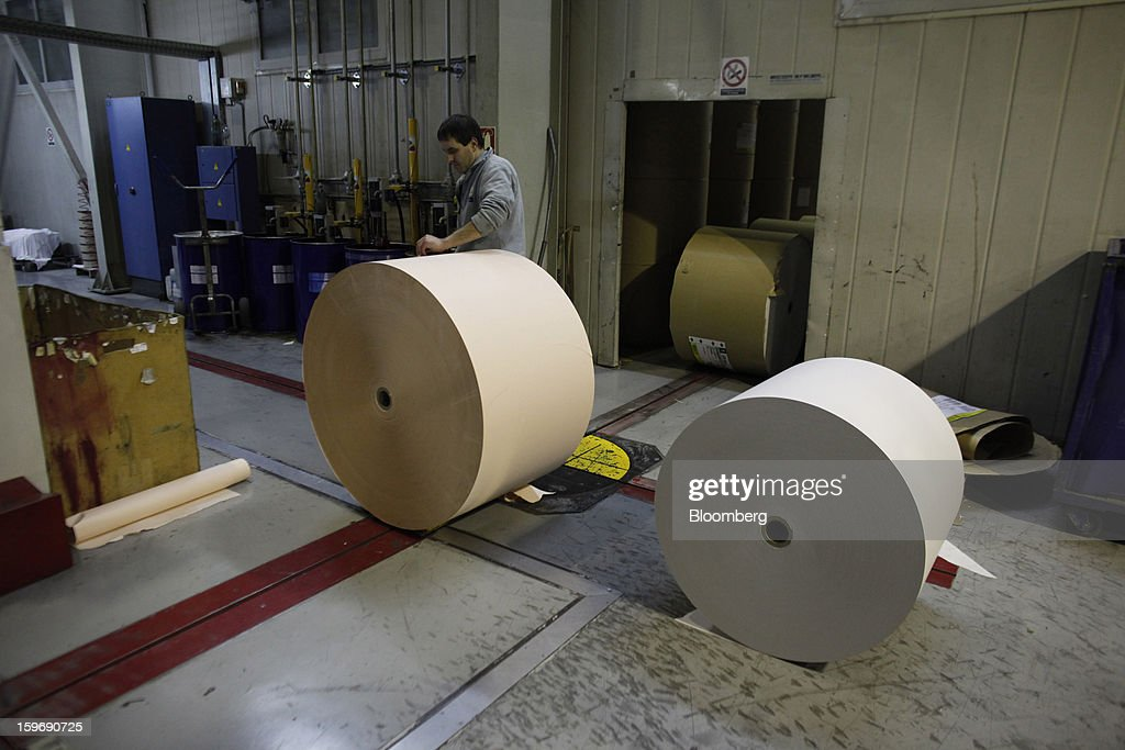 A worker prepares rolls of newsprint paper at the Kathimerini printing plant in Paiania, Greece, on Thursday, Jan. 17, 2013. An anarchist group claimed responsibility for a series of attacks early on Jan. 11 when unidentified perpetrators threw makeshift bombs made from propane gas canisters into the homes of five Greek journalists working for national media saying it was to protest coverage of the country's financial crisis seen as sympathetic to the government. Photographer: Kostas Tsironis/Bloomberg via Getty Images