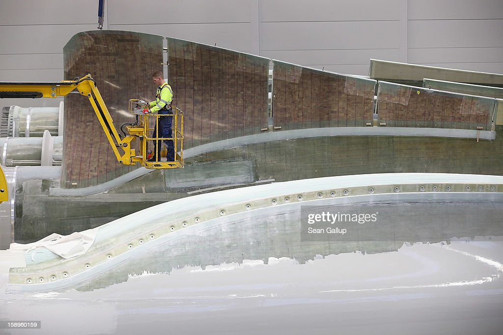 A worker prepares rotor blades for wind turbines at the Enercon wind turbine factory on January 4, 2013 in Aurich, Germany. Germany is invetsing heavily in alternative energy sources and has set a high priority on onshore and offshore wind farms.