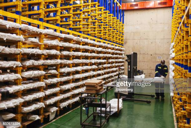 A worker prepares sacks of gold in a storage bay awaiting ahead of delivery to the vault at the Rand Refinery Ltd plant in Germiston South Africa on...