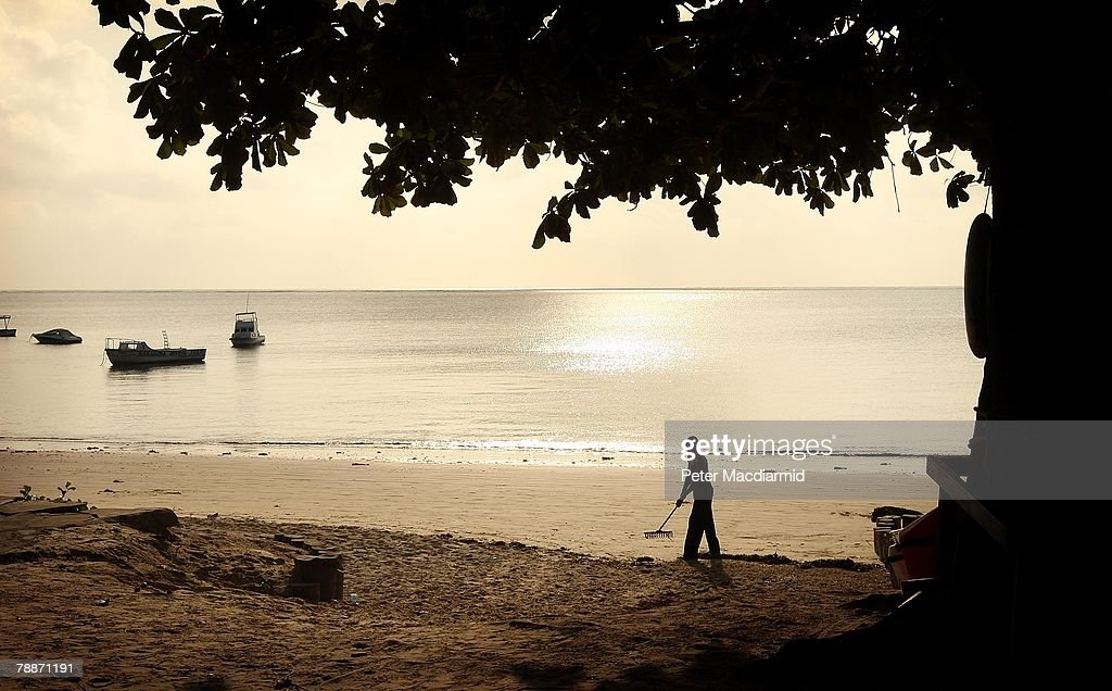 A worker prepares the beach near a private resort hotel on January 10, 2008 in Mombasa, Kenya. Tourism is a $1 billion industry in Kenya. Some tour operators have temporarily banned package holidays over fear of post election violence.