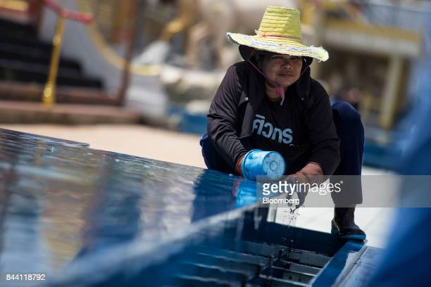 A worker prepares the ceremonial ground for King Bhumibol Adulyadej's ceremony at Sanam Luang park in Bangkok Thailand on Friday Sept 8 2017 The...