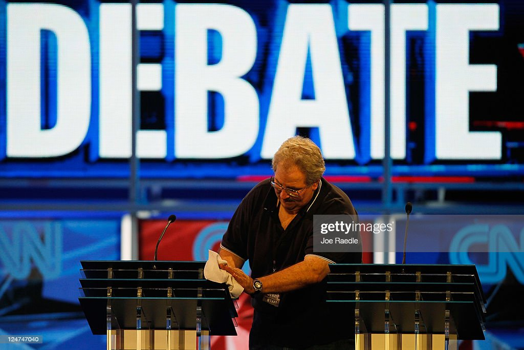 A worker prepares the podiums for this evenings Republican presidential debate sponsored by CNN and The Tea Party Express at the Florida State...