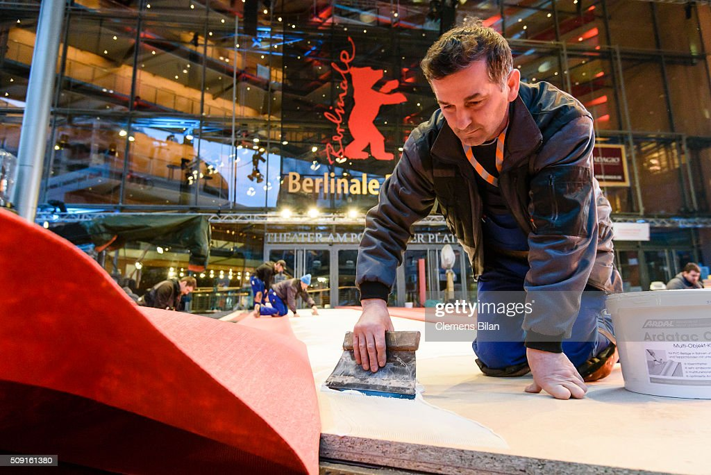 A worker prepares the red carpet prior to the 66th Berlinale at Berlinale Palast on February 9, 2016 in Berlin, Germany.