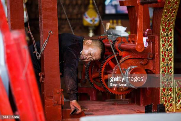 A worker prepares the royal funeral chariot for the cremation ceremony of King Bhumibol Adulyadej at the Bangkok National Museum in Bangkok Thailand...