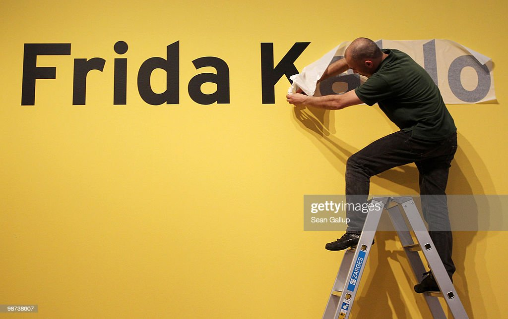 A worker prepares the sign at the entrance to the retrospective exhibition of Mexican painter Frida Kahlo at Martin-Gropius-Bau on April 29, 2010 in Berlin, Germany. The exhibition, which is the biggest exhibition of Kahlo's work in Germany ever, will be open to the public from April 30 to August 9.