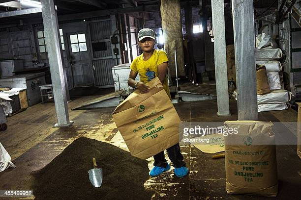 A worker prepares to pack tea into bags at the packing section of the Makaibari Tea Estate factory in Kurseong West Bengal India on Monday Sept 8...