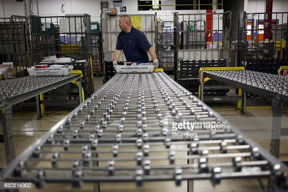 A worker prepares to sort a tray of mail at the United States Postal Service sorting center in Louisville Kentucky US on Friday Jan 13 2017 Starting...
