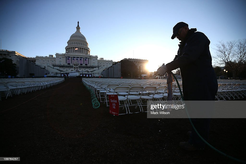 A worker prepares to wipe down chairs, set up in front of the U.S. Capitol Building on January 20, 2013 in Washington, DC. Washington is preparing for the second inauguration of U.S. President Barack Obama, which will take place on January 21.