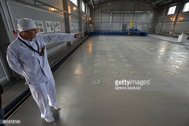 A worker presents to journalists a longterm storage facility of sealed radioactive sources in the centralized store at the manufactures complex...