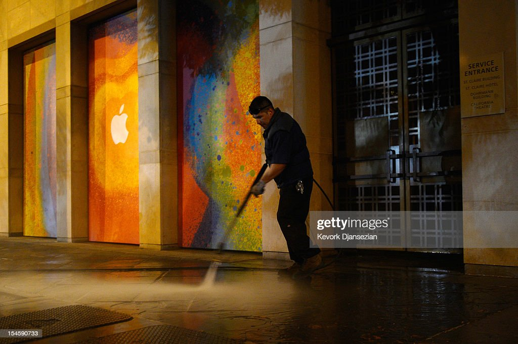 A worker pressure washes the sidewalk at the historic California Theater on October 22, 2012 in San Jose, California. Apple is set to introduce its long-rumored iPad Mini during a news conference on Tuesday.