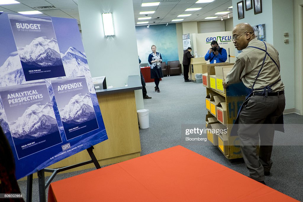 A worker pulls a cart with copies of U.S. President Barack Obama's Fiscal Year 2017 Budget at the Government Publishing Office bookstore in Washington, D.C., U.S., on Tuesday, Feb. 9, 2016. Obama will send a fiscal 2017 budget of about $4 trillion to the Republican-controlled Congress on Tuesday representing his aspirations for the future of the U.S. Photographer: Pete Marovich/Bloomberg via Getty Images