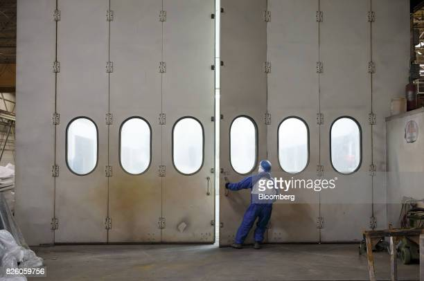 A worker pulls a door open at the Automatic Coating Ltd facility in Toronto Ontario Canada on Wednesday Jan 11 2017 Statistics Canada is scheduled to...