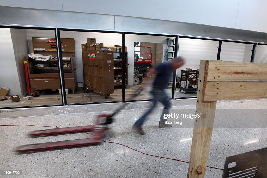 A worker pulls a hand fork lift inside a new Whole Foods Market Inc. store under construction in Park Ridge, Illinois, U.S., on Tuesday, Sept. 17, 2013. Whole Foods is currently scheduled to open eleven new stores in the U.S. and 2 in the U.K by the fall 2014, according to its website. Photographer: Tim Boyle/Bloomberg via Getty Images