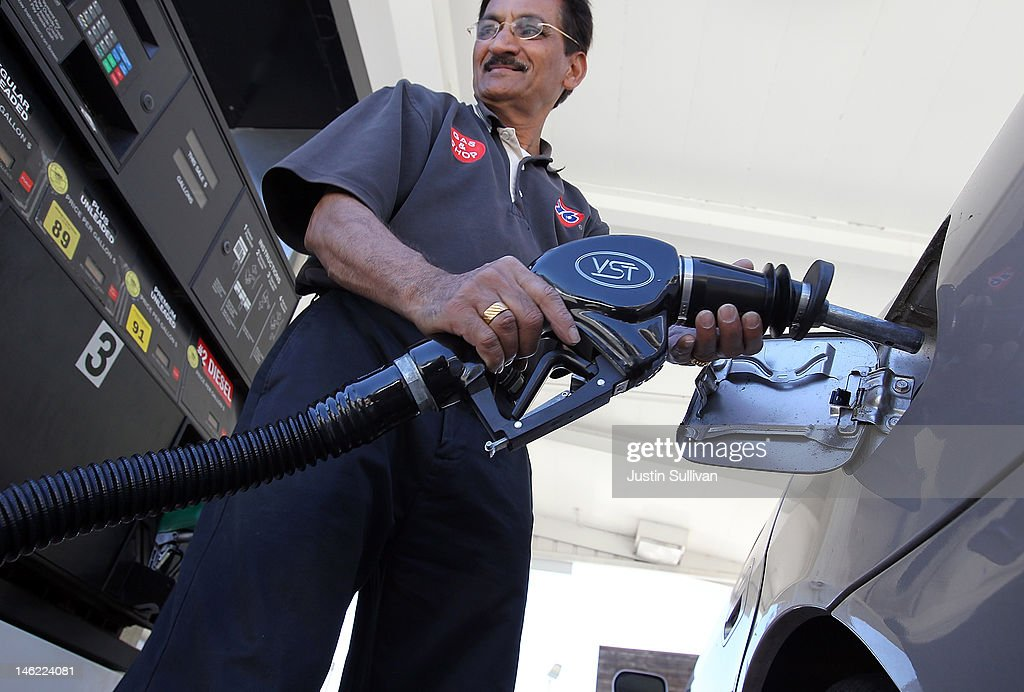 A worker pumps gasoline into a car on June 12, 2012 in San Anselmo, California. According to the Energy Department's weekly fuel survey, the average pump price in California dropped 9.6 cents in the past week to bring the price of a gallon of regular gasoline to $4.164 compared to $4.260 one week earlier.