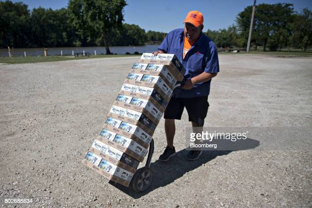 A worker pushes cases of Constellation Brands Inc Corona beer during a delivery in Ottawa Illinois US on Tuesday June 27 2017 Constellation Brands...