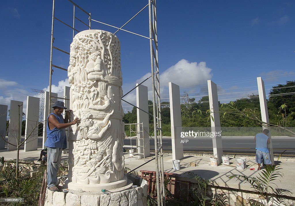 A worker puts finishing touches before the opening of Santuario de la Esperanza (Sanctuary of Hope) similar to the Mayan steles, during preparations for the celebration of the end of the Maya Long Count Calendar --Baktun 13-- and the beginnig of a new era on December 18, 2012 in Cancun, Quintana Roo state, Mexico. AFP HOTO/Pedro Pardo
