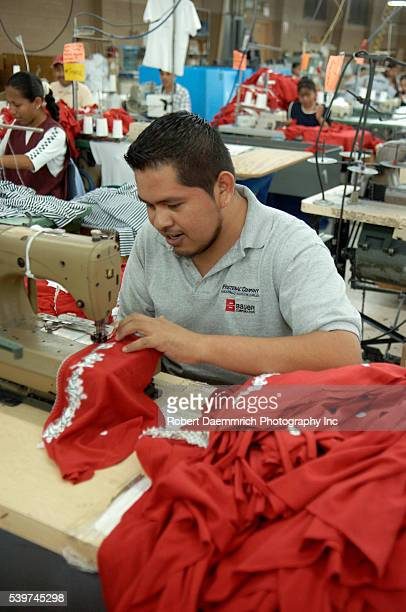 A worker puts finishing touches on clothing at the BonWorth clothing factory in Mexico on March 24 2006 Clothing manufacturer BonWorth factory has...