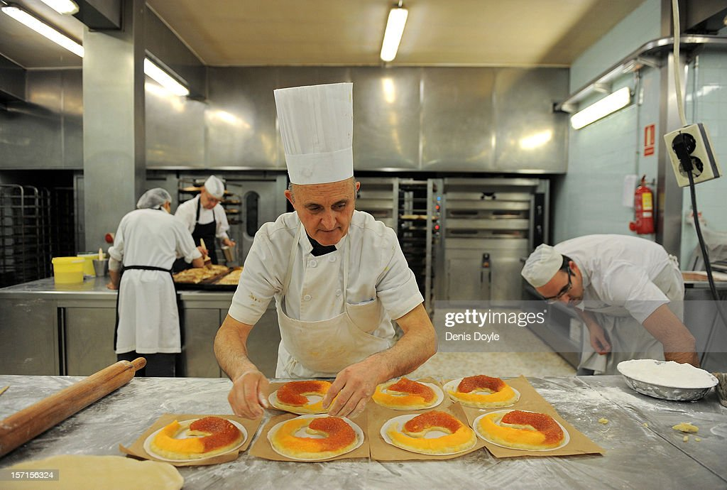 A worker puts the finishing touches to a traditional hand made 'Anguila' (eel shaped) mazapan christmas cake at the Santo Tome Obrador de Mazapan cake bakery on November 28, 2012 in Toledo, Spain. The basic ingrediants of the Spanish mazapan cake is almonds, sugar, honey and eggs. The company, which employs 45 staff throughout the year, has hired an extra 25 workers leading up to the christmas festivities hoping consumption picks up over the holiday period.