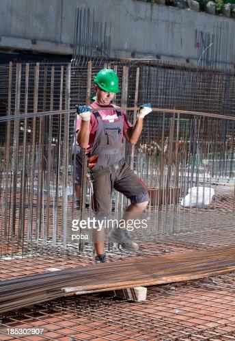 worker rebar on construction site positions secures steel reinforcing bar stock photo rebar worker