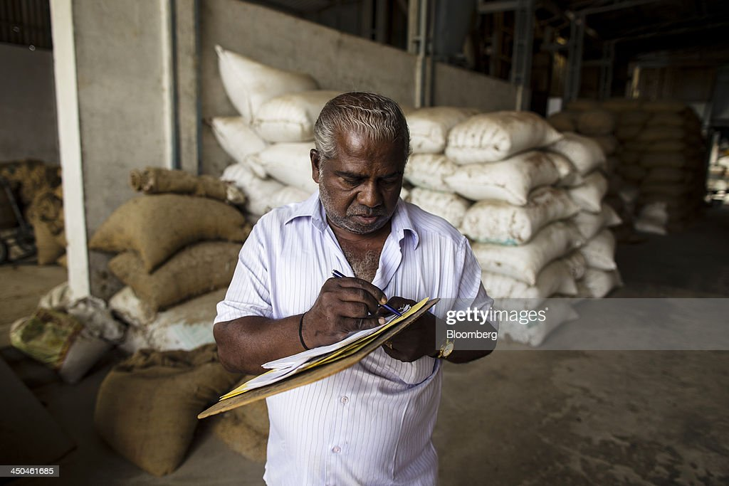 A worker records the weight of bags of rice grain as they arrive to be dehusked and polished at the KRK Modern Rice Mill in Kothapeta, Tamil Nadu, India, on Thursday, Nov. 14, 2013. Record onion prices and the soaring cost of rice and coriander are frustrating Reserve Bank of India Governor Raghuram Rajans battle to curb inflation while supporting growth in Asias third-largest economy. Photographer: Prashanth Vishwanathan/Bloomberg via Getty Images
