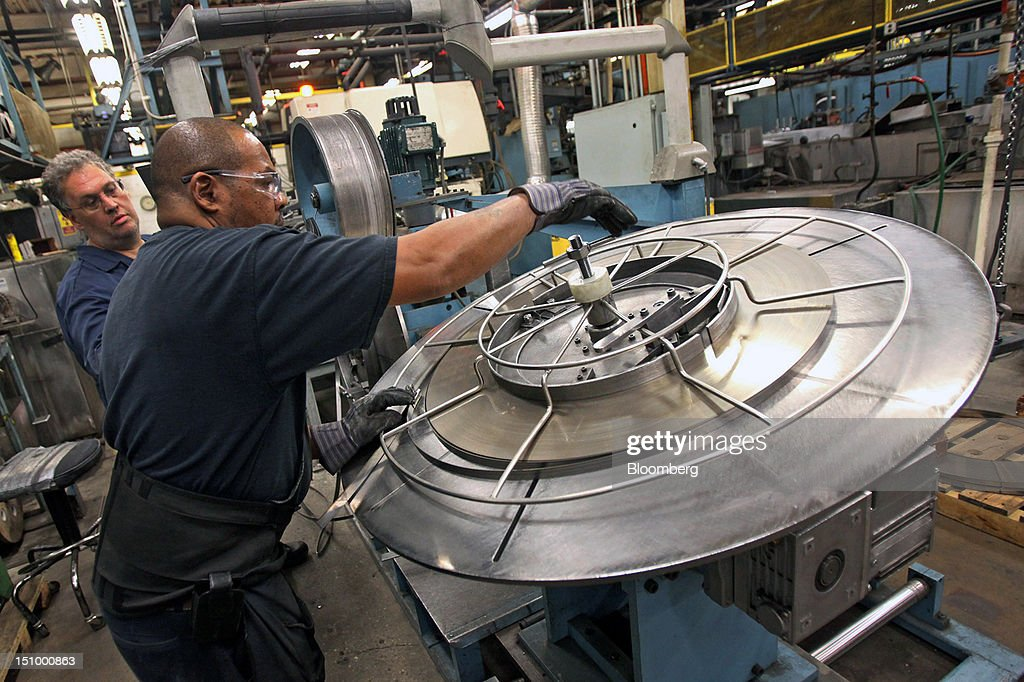 A worker removes a coil of steel for manufacturing band saw blades at DoALL Company's Contour Saws Inc. facility in Des Plaines, Illinois, U.S., on Tuesday, Aug. 28, 2012. The U.S. Census Bureau is scheduled to release factory orders data on Aug. 31. Photographer: Tim Boyle/Bloomberg via Getty Images