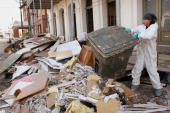 A worker removes debris from an art gallery in the Strand District after it was flood damaged by Hurricane Ike September 19 2008 in Galveston Texas...