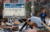 A worker removes debris from Monte Calvario church after it was flood damaged by Hurricane Ike September 21 2008 in Galveston Texas Although much of...