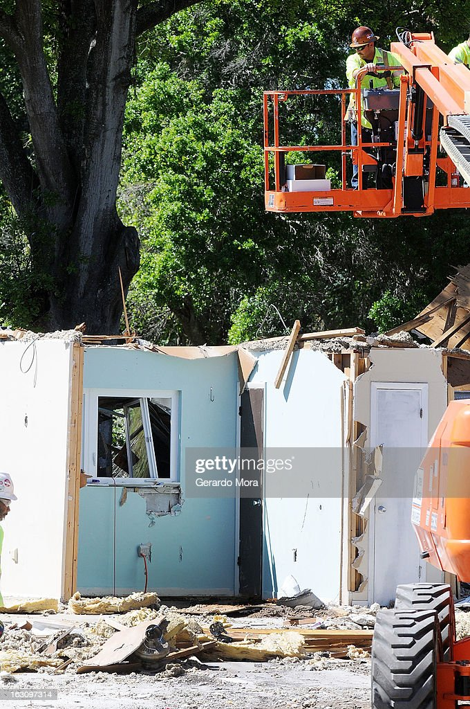 A worker removes debris from the home where a sinkhole swallowed Jeffrey Bush on March 4, 2013 in Seffner, Florida. Jeff Bush, presumed dead after a sinkhole, estimated at 60 feet deep, opened under his bedroom while he was sleeping in the home. Demolition crews are working to raze the house, recover possessions, and stabilize the now-shaky ground.