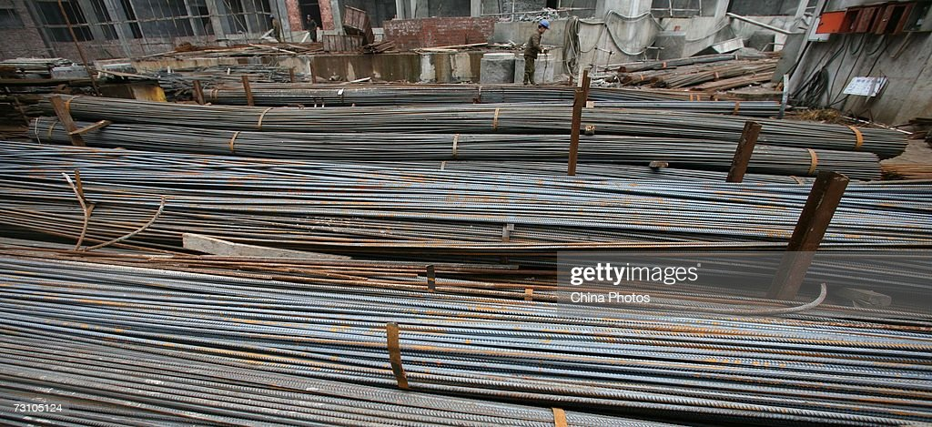 A worker removes rolled steel at a construction site on January 25 2007 in Chongqing Municipality China China's steel exports hit a record high in...