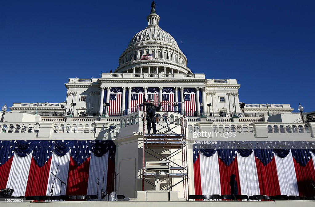 A worker removes scaffolding at the west front of the Capitol building where President Barack Obama take the oath of office during his second inauguration on January 19, 2013 in Washington, D.C. Preparations continued ahead of Monday's historic event, which is expected to draw more than half a million people.
