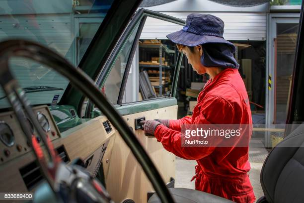 Worker repair to door knob at mohenoc garages in Paju South Korea A 20yearold beat up Hyundai SUV isn't anyone's idea of a dream car But used Hyundai...
