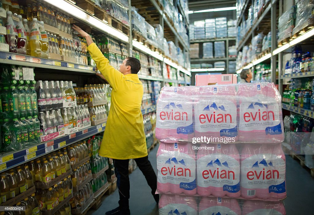 A worker restocks shelves with bottles of Evian spring water, produced by Danone SA, inside a Metro Cash & Carry store, the Russia unit of Metro AG, in Moscow, Russia, on Friday, Aug. 29, 2014. Metro Cash & Carry has warned that domestic food suppliers are trying to increase some food prices as local produce is substituted for EU, Norwegian and U.S. equivalents which have been sanctioned. Photographer: Andrey Rudakov/Bloomberg via Getty Images