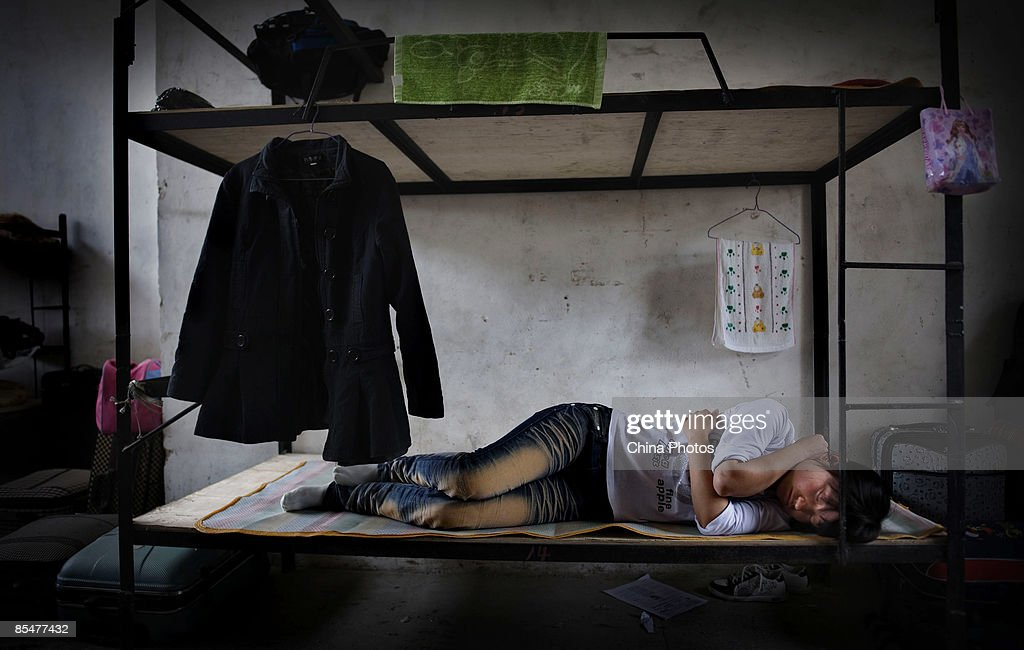 A worker rests at the Shenzhen Quanshun Human Resources Co. Ltd. on February 26, 2009 in Shenzhen, Guangdong Province, China. The company, which was established by entrepreneur Zhang Quanshou, supplies workers to enterprises in the Guangdong and Fujian provinces. Since 1997 Zhang has recruited migrant workers and leased them to factories, once the production order of a company is finished workers are then transferred to another one.