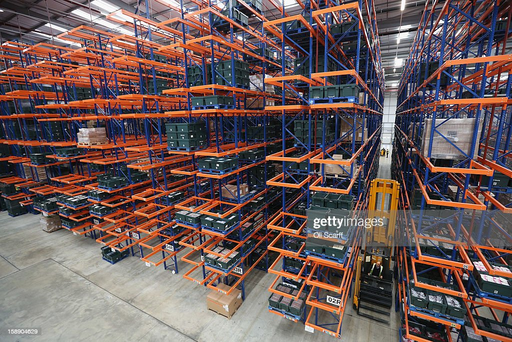 A worker rides a lift in the giant semi-automated distribution centre where the company's partners process the online orders for the John Lewis department store on January 3, 2013 in Milton Keynes, England. John Lewis has published their sales report for the five weeks prior December 29, 2012 which showed online sales had increased by 44.3 per cent over the same period in 2011. Purchases from their website Johnlewis.com now account for one quarter of all John Lewis business.