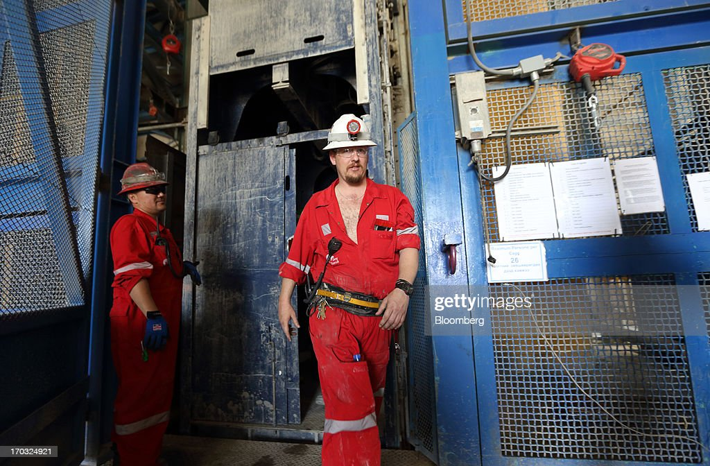 A worker, right, exits the No.1 shaft as he returns from the underground pit at the Oyu Tolgoi copper-gold mine, jointly owned by Rio Tinto Group's unit Turquoise Hill Resources Ltd. and Erdenes Oyu Tolgoi LLC, in Khanbogd, the South Gobi desert, Mongolia, on Friday, June 7, 2013. Rio Tinto, the world's second-biggest mining company, is expected to start first shipments from its $6.6 billion copper-gold mine in Mongolia this month. Photographer: Tomohiro Ohsumi/Bloomberg via Getty Images