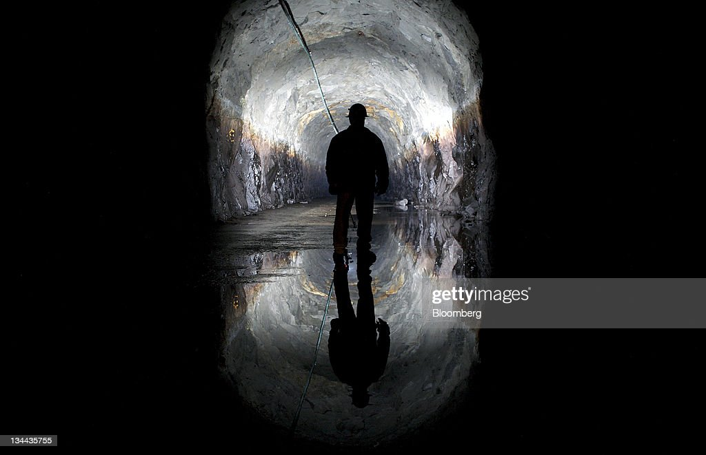 Worker Sam Danner inspects part of the four mile long Tail Race tunnel in which water travels after exiting the Sacramento Municipal Utility District (SMUD) Loon Lake Power Station in Loon Lake, California, U.S., on Thusrday, Nov. 3, 2011. The Sacramento Municipal Utility District (SMUD), which provides electricity to Sacramento County and a small portion of Placer County, is one of the ten largest publicly owned utilities in the U.S., generating the bulk of its power through natural gas and large hydroelectric generation plants. Photographer: Ken James/Bloomberg via Getty Images