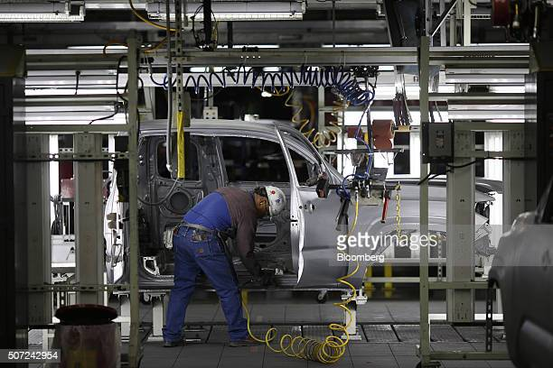 A worker sands down the edges of a truck frame on the assembly line at the Toyota Motor Corp manufacturing facility in San Antonio Texas US on...