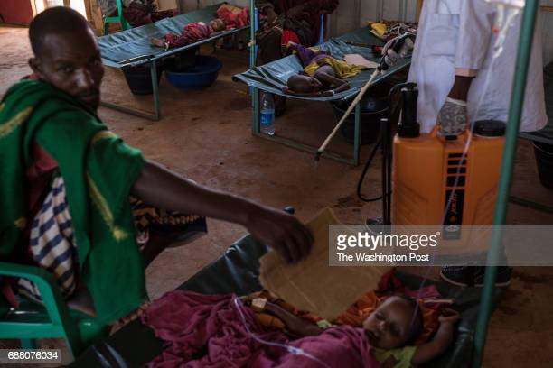 A worker sanitizes a cholera treatment center at a regional hospital in Baidoa Somalia on May 11 2017 The Bay region of Somalia in which Baidoa is...