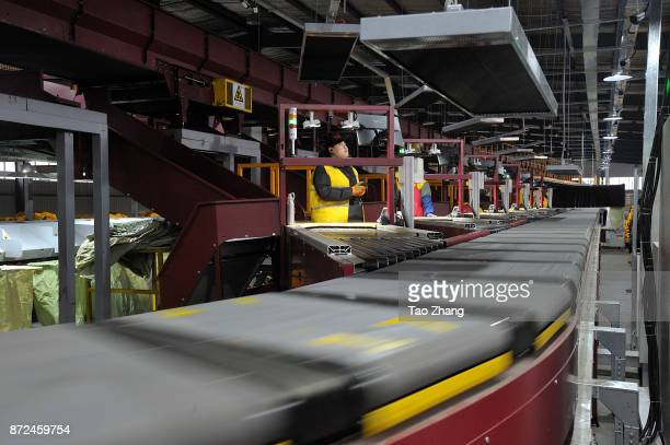 A worker scan deliver machine on November 10 2017 in Harbin China November 11 is known in China as Singles Day because the date 1111 resembles four...