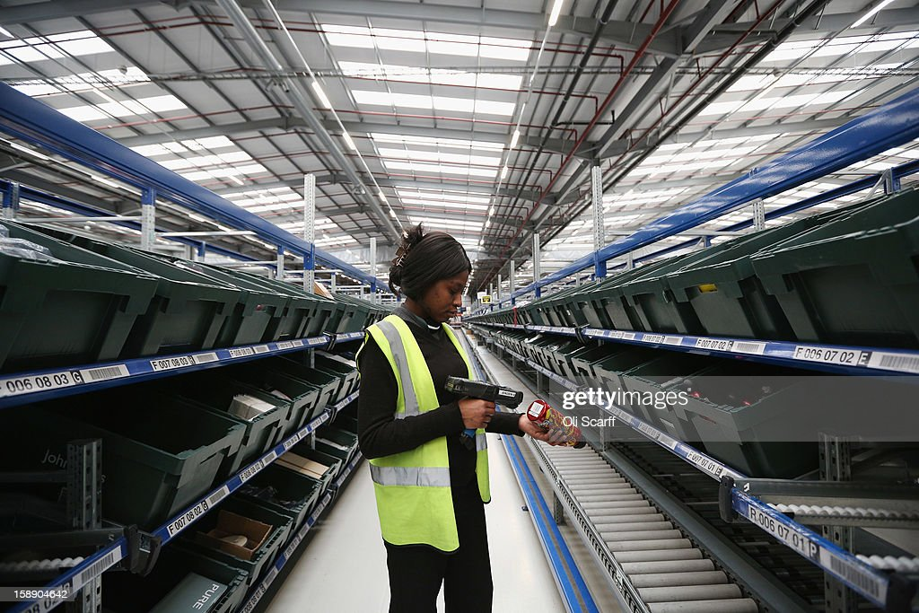 A worker scans an item in the giant semi-automated distribution centre where the company's partners process the online orders for the John Lewis department store on January 3, 2013 in Milton Keynes, England. John Lewis has published their sales report for the five weeks prior December 29, 2012 which showed online sales had increased by 44.3 per cent over the same period in 2011. Purchases from their website Johnlewis.com now account for one quarter of all John Lewis business.