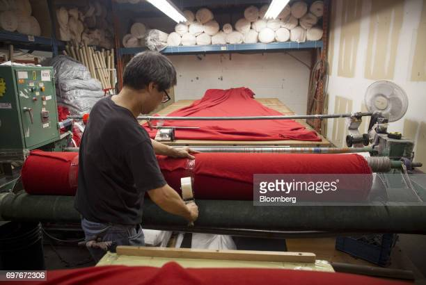 A worker seals a roll of fabric at the WS Co production facility in Toronto Ontario Canada on Friday June 9 2017 Canada Day celebrates the...