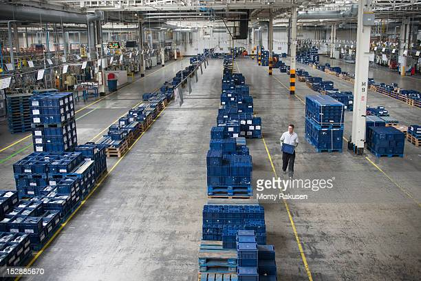 Worker selecting car parts in car factory