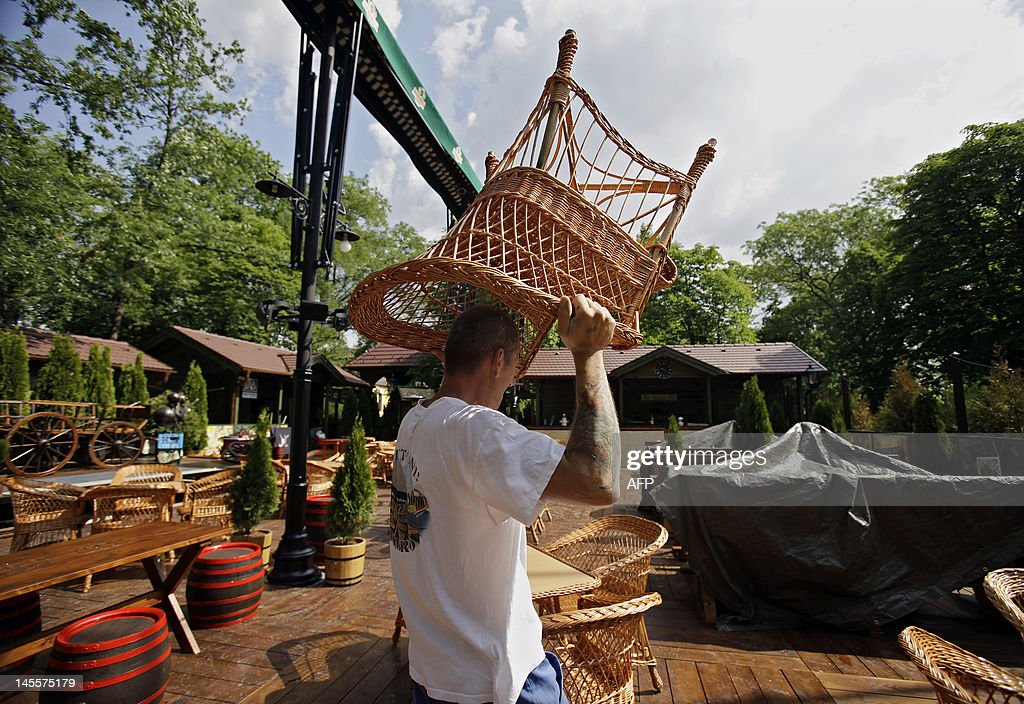 A worker sets out chairs in the beer garden of Freedom square in Gyomro town on May 24, 2012. The decision to rename the main square of a Hungarian town named after the former Hungarian Regent Miklos Horthy, from 1920 to 1944, an ally of Adolf Hitler, evokes emotion and shows a certain rise of nationalism to extreme right in the country.