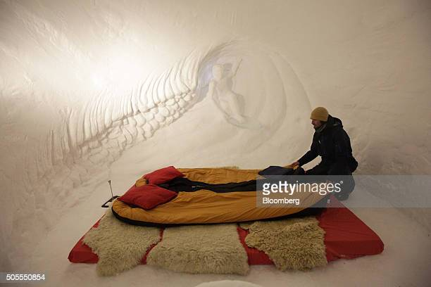 A worker sets up a bedroom inside the igloo hotel operated by IgluDorf GmbH on the Parsenn mountain in this arranged photograph in Davos Switzerland...