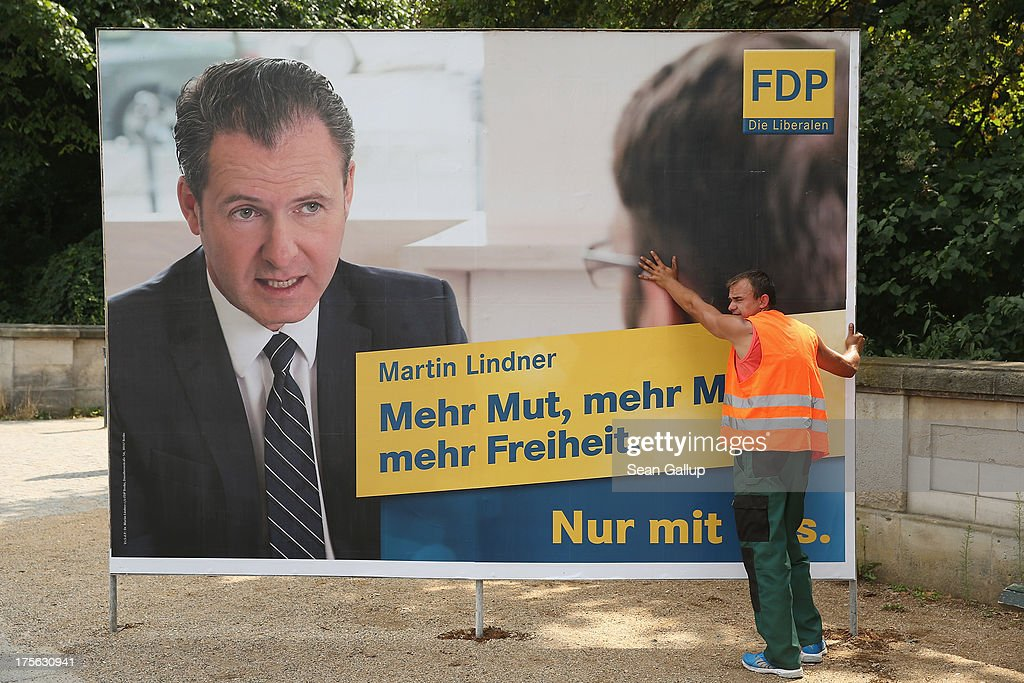 A worker sets up election campaign poster of the German Free Democrats (FDP) in the city center on August 6, 2013 in Berlin, Germany. Germany is scheduled to hold federal elections on September 22 and so far current Chancellor Angela Merkel and her party, the German Christian Democrats (CDU), have a strong lead over the opposition.